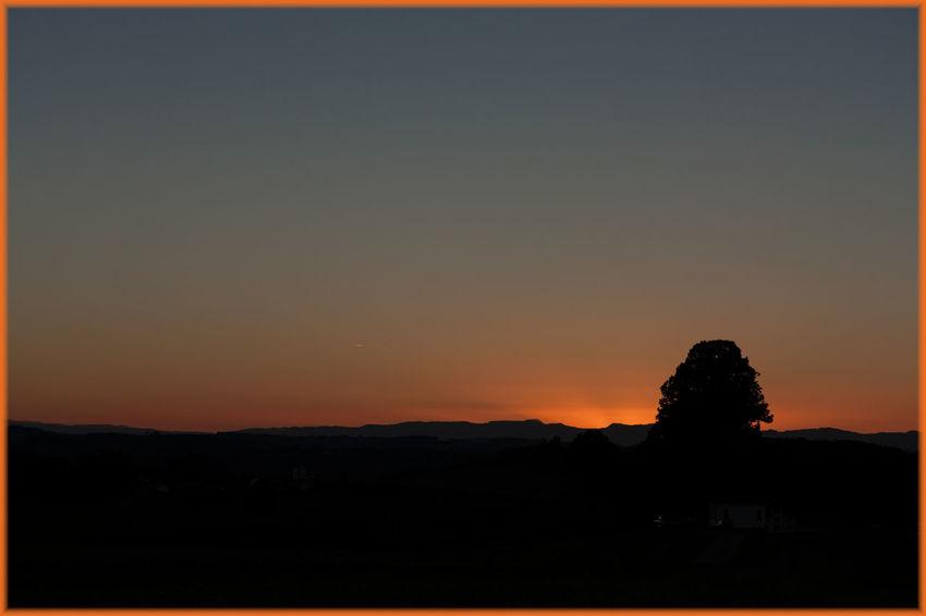 Beauty In Nature Idyllic Landscape Nature Non Urban Scene Orange Color Outdoors Silhouette Sky Sunset
