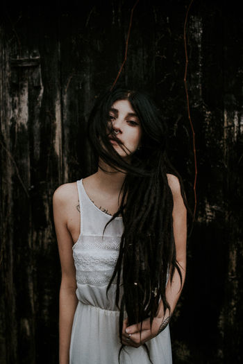 Beautiful Woman Black And White Dreadlocks Fairy Focus On Foreground Lifestyles Long Hair Melancholy Moody Outdoors Portrait Simplicity Tattoo The Portraitist - 2017 EyeEm Awards White Dress White Skin Young Adult International Women's Day 2019