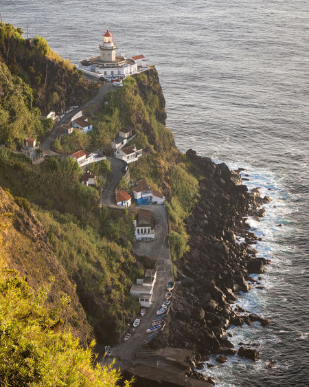 View of farol do arnel, the oldest lighthouse on sao miguel island, azores