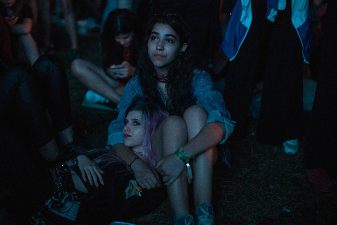 sitting, night, horror, young adult, leisure activity, young women, movie, lifestyles, togetherness, real people
