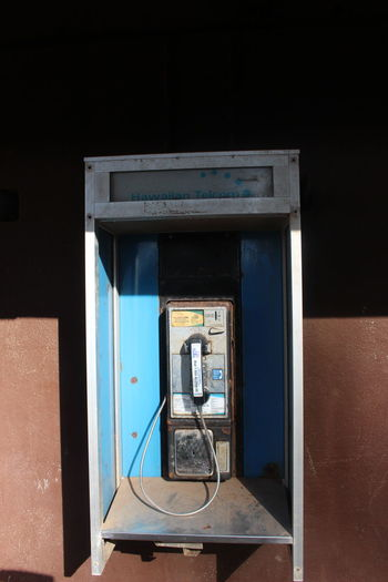 Telephone booth against wall