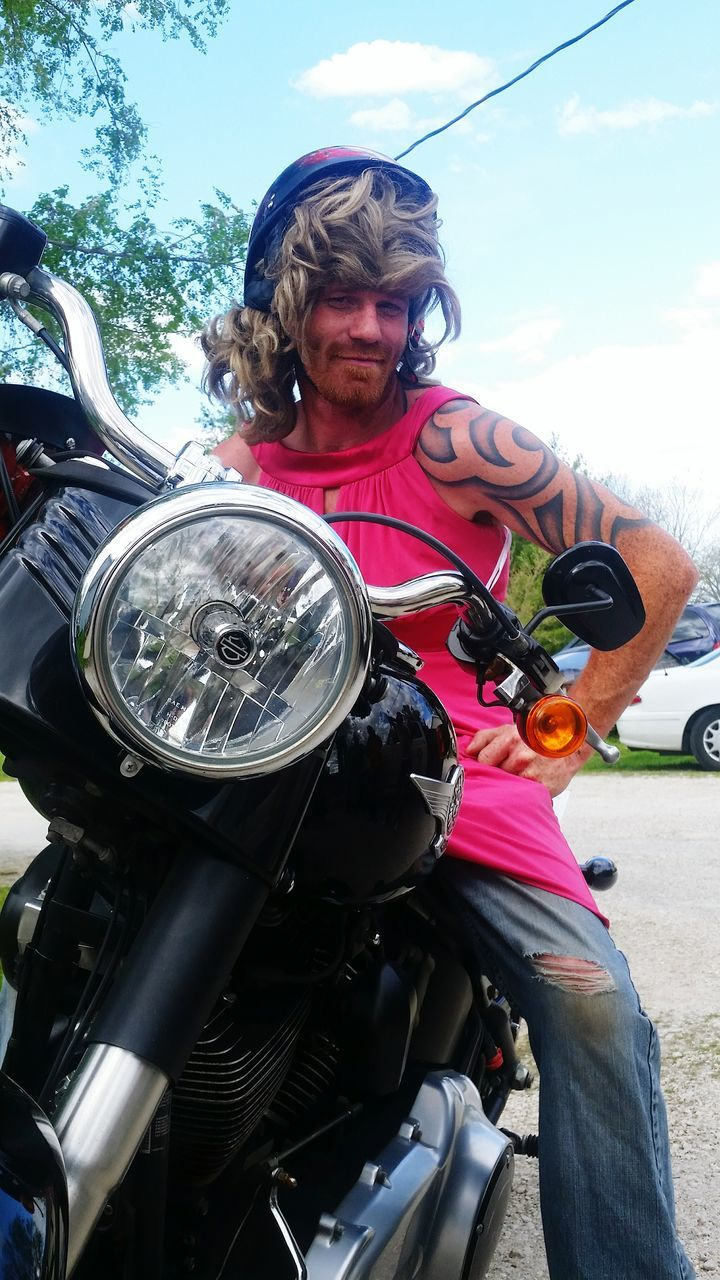 motorcycle, transportation, mode of transport, one person, land vehicle, riding, outdoors, day, biker, front view, beard, lifestyles, real people, sitting, driving, leisure activity, road, mature adult, road trip, men, helmet, headwear, scooter, sky, adult, people