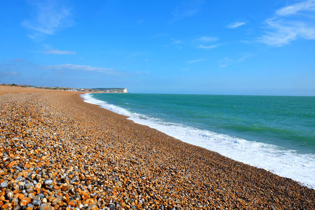 Pebble Beach Seaford Beach Beauty In Nature Blue Cloud - Sky Day Horizon Horizon Over Water Idyllic Land Motion Outdoors Pebble Pebbles On A Beach Scenics - Nature Sea Seaford Head Sky Sweeping Shore Sweeping Shoreline Tranquil Scene Tranquility Water Wave