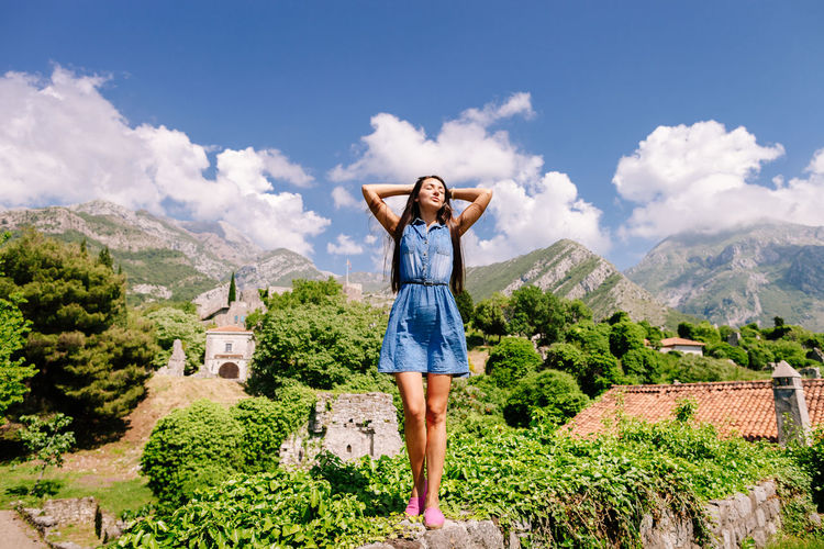 woman travel on vacations and relax. Leisure time. One female with long hair in mountains. Autumn Freedom Happiness Nature Travel Beauty In Nature Day Landscape Leisure Activity Lifestyles Long Hair Montenegro Mountain Nature One Person One Woman Only Outdoors Real People Scenics Sky Springtime Standing Summer Travel Destinations Young Adult