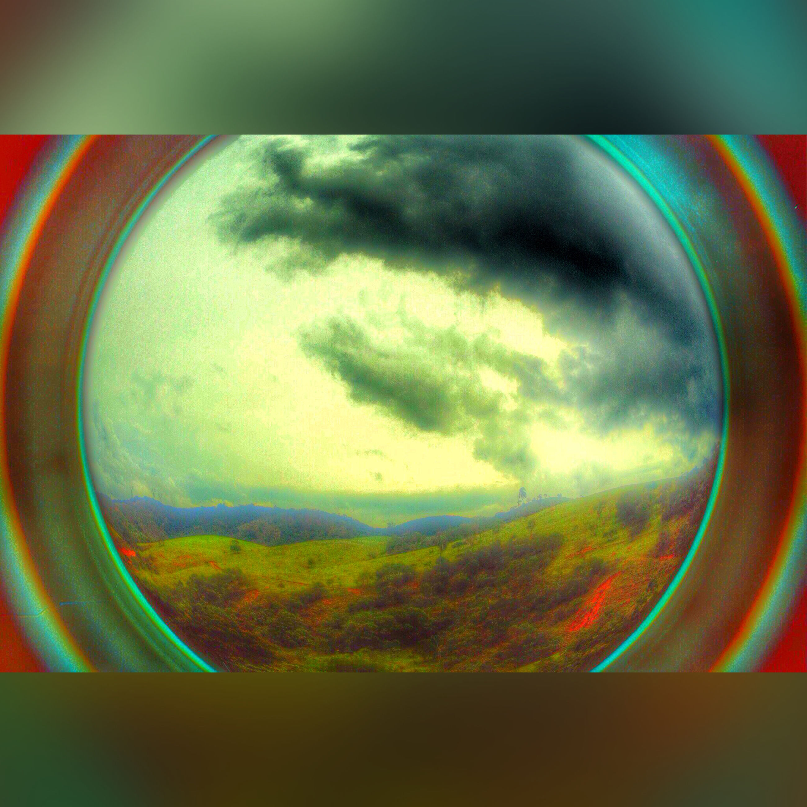 transparent, glass - material, circle, sky, indoors, close-up, geometric shape, window, sphere, blue, reflection, multi colored, no people, round, shape, nature, cloud - sky, glass, rainbow, circular