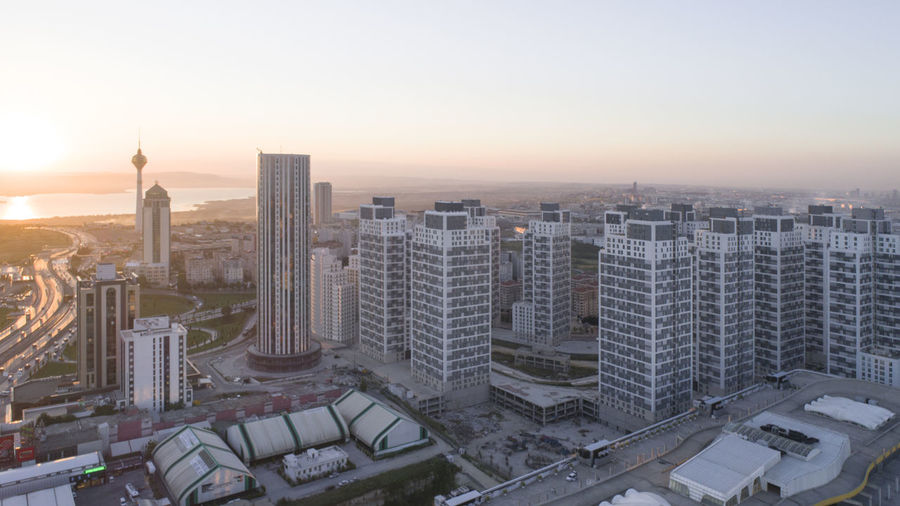 High angle view of buildings in city during sunset