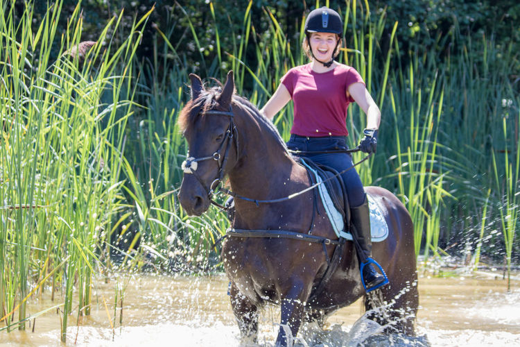 Brown Casual Clothing Close-up Day Domestic Animals Full Length Horse Jumping Leisure Activity Lifestyles Mammal One Animal Ouside Outdoors Person Riding Horses Sitting Summer Activities Summer Activity Summer Fun Summer Fun ☀️ Teenagers  Water Young Adult