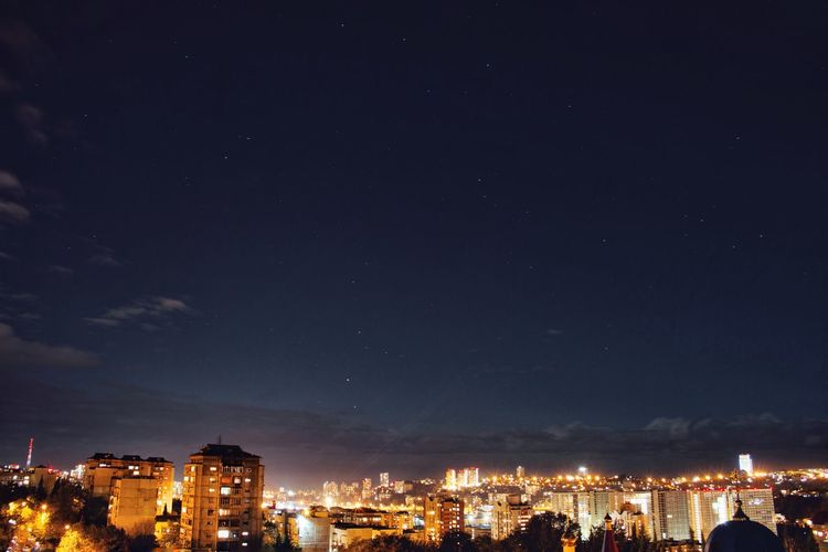 High Section Of Illuminated Cityscape Against Sky At Night