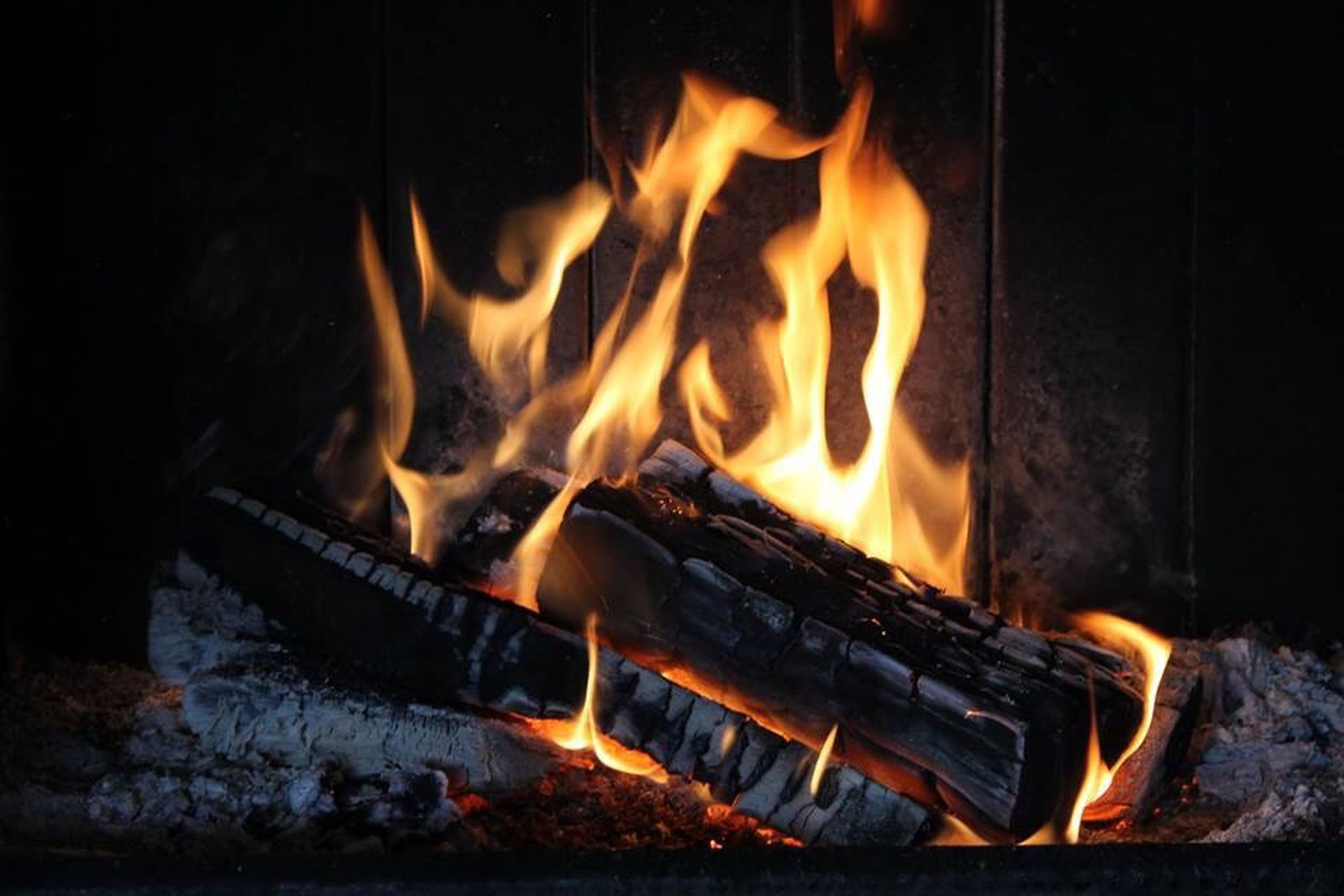 flame, burning, heat - temperature, fire - natural phenomenon, orange color, bonfire, fire, firewood, glowing, heat, night, campfire, motion, high angle view, no people, outdoors, auto post production filter, close-up, wood - material