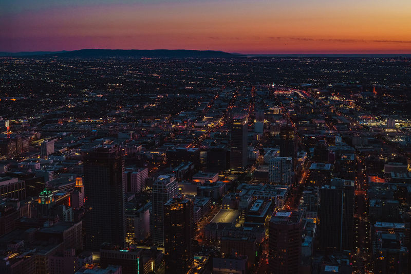 Aerial View Of City Lit Up At Sunset