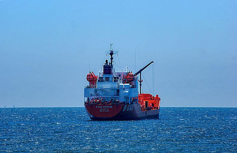 Ship on sea against clear sky