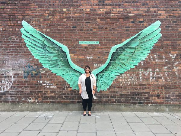The original liver bird Full Length Only Women One Woman Only Brick Wall One Person Day Mid Adult Adults Only Outdoors Adult Standing One Young Woman Only Flying People Portrait Young Adult City Spread Wings Young Women Architecture