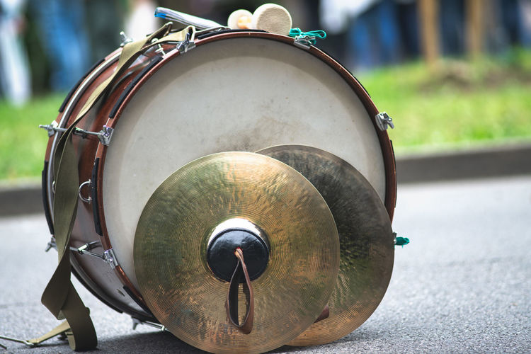 Close-up of musical instrument on road