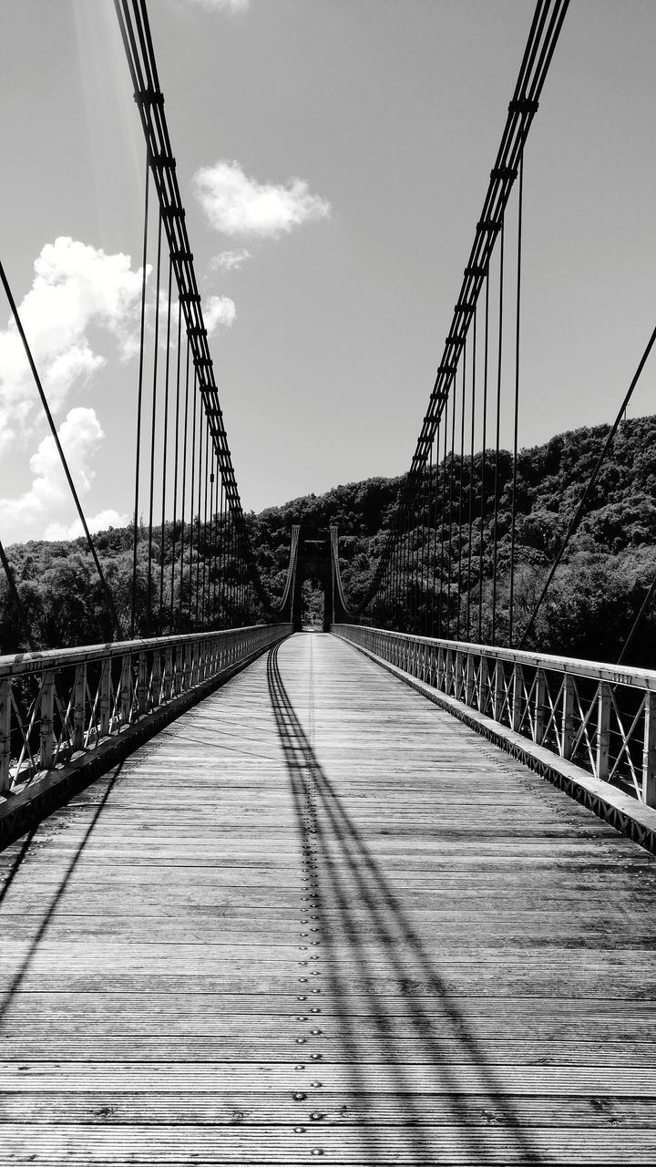 connection, bridge, bridge - man made structure, transportation, built structure, the way forward, direction, engineering, architecture, sky, nature, diminishing perspective, suspension bridge, cloud - sky, railing, day, vanishing point, footbridge, outdoors, long