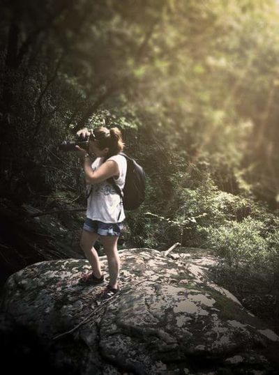 So this is me on a rock doing my thingFull Length One Person Only Women One Woman Only Adult Casual Clothing Forest Standing Day Adventure Nature Outdoors Tree Photographer Camera Ponytail