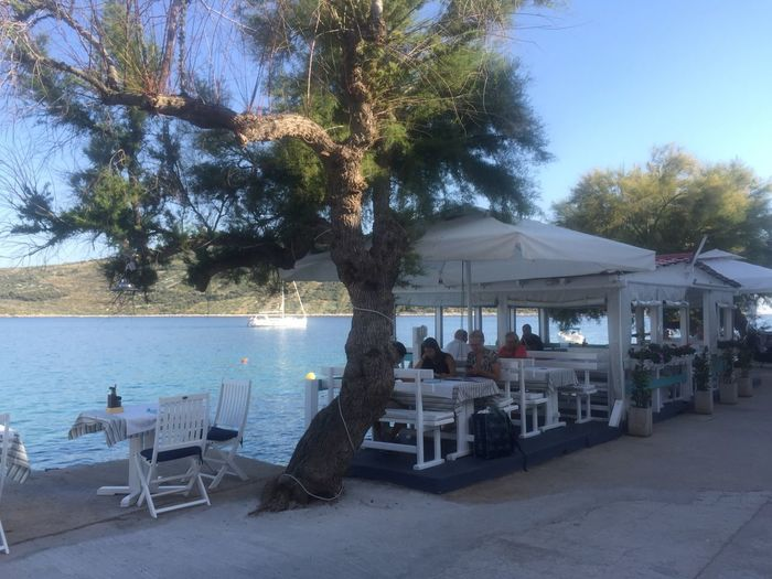 Mediterrana Croatia Table Tree Chair Beach Restaurant Outdoor Cafe Relaxation Sea Nature Outdoors Clear Sky Vacations Day Sky Scenics Architecture Water Beauty In Nature Branch