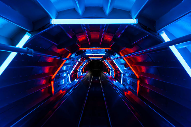 Go in other dimension Architecture Atomium Blue Futuristic Illuminated Indoors  Modern No People Steps And Staircases The Way Forward Transportation Tunnel