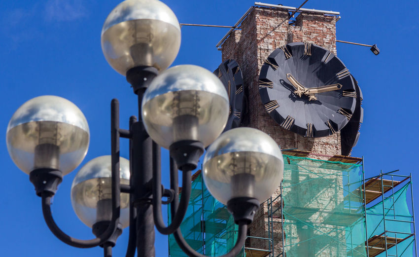 Street Light City Clock Scaffolding Chimes Architecture Blue Building Building Exterior Built Structure Clear Sky Close-up Day Lighting Equipment Low Angle View Metal No People Outdoors Silver Colored Sky