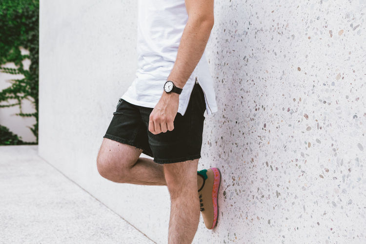 Young Man casually dressed wearing analog watch in the Urban environment One Person Real People Midsection Human Body Part Body Part Day Lifestyles Human Leg Men Low Section Outdoors Casual Clothing Leisure Activity Walking Rear View Standing Focus On Foreground Adult Shorts Human Limb Watch Wrist Watch Jewellery Jewelry Young Adult Young Men City City Life Urban Street