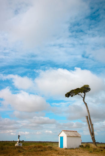 Outdoors Beauty In Nature Nature Sky Ocean Atlantic Ocean Seaside Sea Loire Atlantique Day Cloud - Sky Architecture Built Structure Land Field No People Environment Landscape Building Exterior Grass History Low Angle View Plant Blue Building The Past The Minimalist - 2019 EyeEm Awards