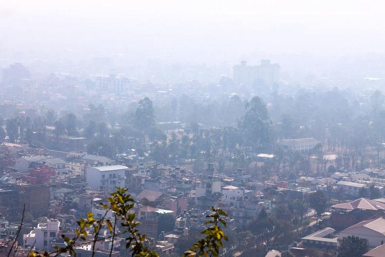 Kathmandu, Nepal Cityscape Fog Over The City City Building Exterior Architecture Cold Temperature Urban Skyline Travel Destinations Winter Built Structure Fog Day Sky Travel Travel Photography