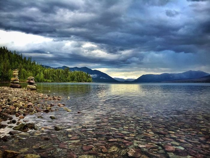 Lake MacDonald Cloud - Sky Mountain Sky Nature Scenics Beauty In Nature Tranquility Tranquil Scene Water Lake Pebble Outdoors No People Mountain Range Day Landscape Storm Cloud Tree Pebble Beach
