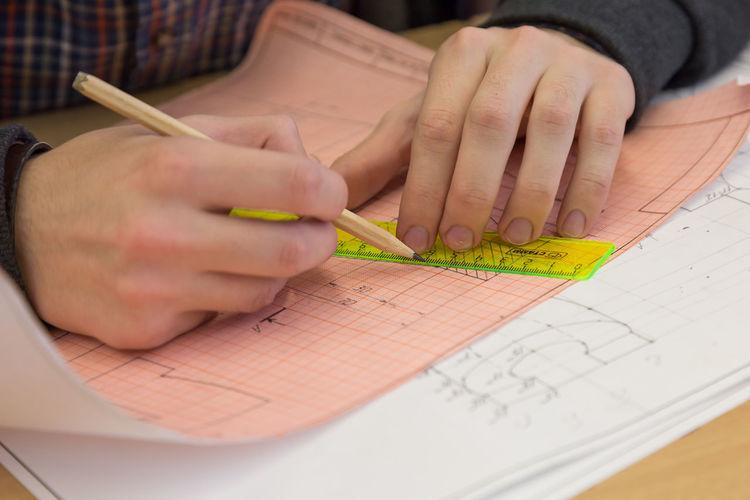 Man drawing diagram on paper at desk