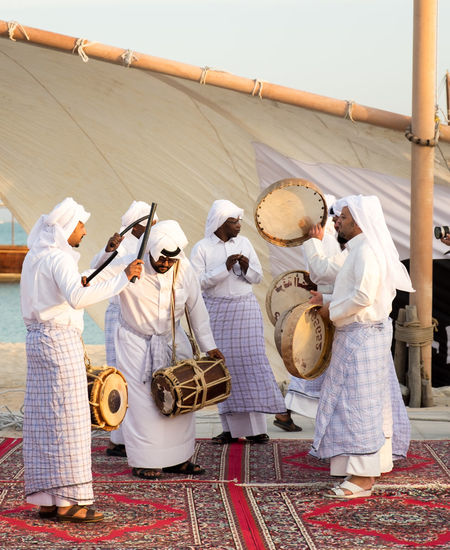 Katara Cultural Village Qatar Doha,Qatar Cultures Culture Hertitage Travel Tourism Arab Gulf Group Of People Men Clothing Music Working Traditional Clothing Teamwork Preparation  Day Drum - Percussion Instrument Cooperation Group Traditional Culture Traditional Musical Instrument Traditional Music