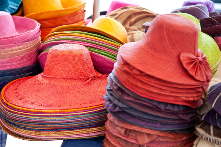 Colorful hats at market for sale