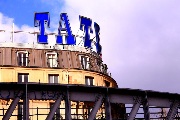 Paris, France  Architecture Blue Building Exterior Built Structure Day Letters In The City Low Angle View No People Outdoors Sky Tati
