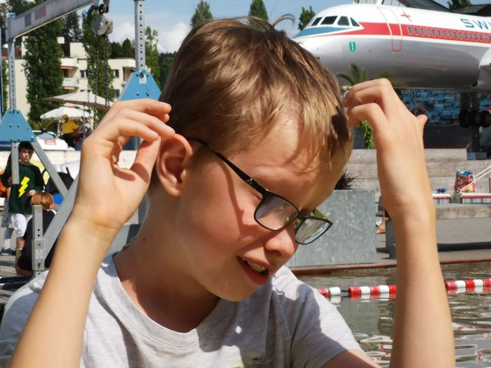 Ouch! Airplane Crash Joke Airplane Boy Casual Clothing Child Childhood Day Eyeglasses  Glasses Incidental People Leisure Activity Lifestyles Museum One Person Outdoors Portrait Real People Teenager Transportation