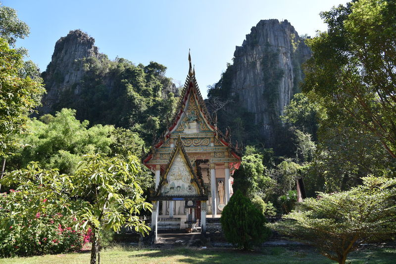 Buddhist Pisanulok Architecture Art Beauty In Nature Built Structure Clear Sky Growth History Mountain Nature No People Outdoors Place Of Worship Plant Religion Rocky Mountains Sky Spirituality Temple Thailandtravel Travel Destinations Tree