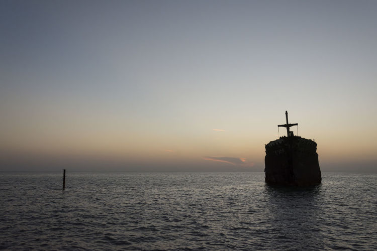 The greek ship wreckage in kish island after sunset Water Sky Sunset Sea Waterfront Beauty In Nature Silhouette Scenics - Nature Architecture Nature No People Horizon Over Water Horizon Tranquil Scene Tranquility Orange Color Built Structure Guidance Clear Sky Outdoors Wreckage Greek Ship Old Vintage