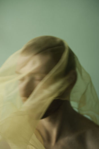 Close-up of woman covering face