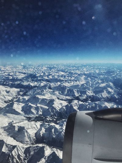 Airplane view over th Mountains Mountain Alps Switzerland Alps Air Vehicle Sky Airplane Flying No People Transportation Nature Mode Of Transportation Scenics - Nature Aerial View Beauty In Nature Travel Outdoors Mid-air Jet Engine Engine Environment Day Blue Landscape