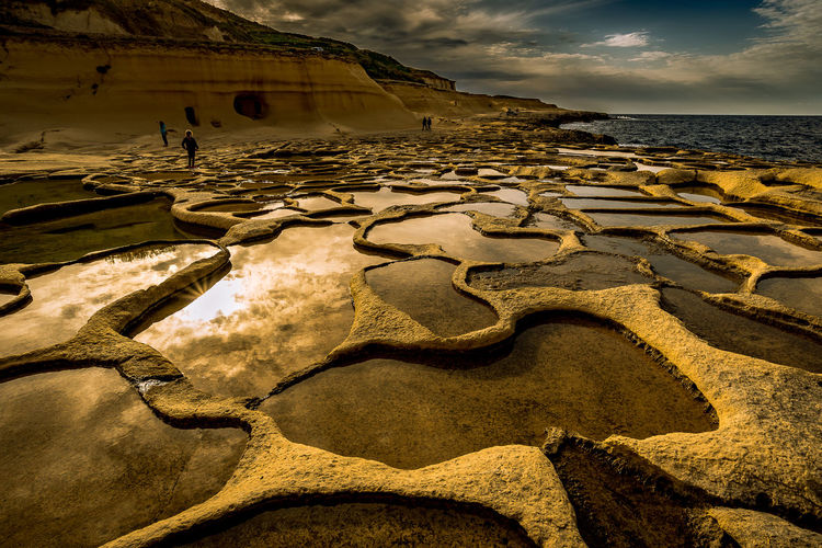 Tidal Pools On Rock Formation At Beach