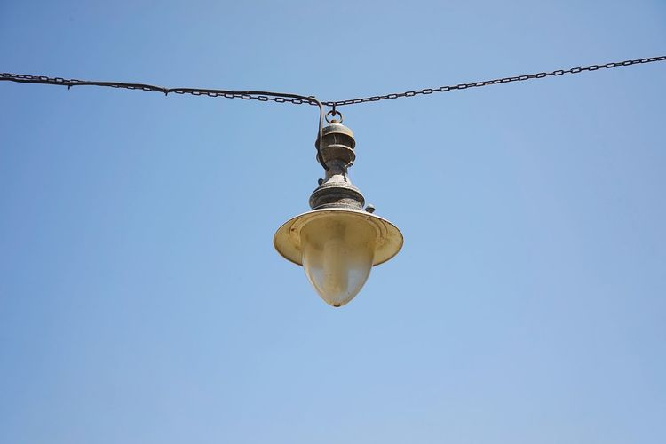 Chania Crete Street Lamp Sky Low Angle View Hanging Clear Sky Blue Nature No People Lighting Equipment Day Copy Space Outdoors Close-up Light Decoration Electricity  Cable Chain Light Bulb Sunlight Electric Light