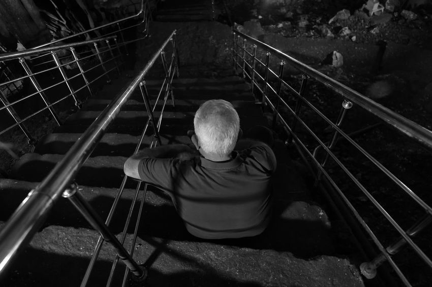 Following a Path Adult Astim Caves Cave Curves And Lines Gray Hair High Angle View Horizontal Metal Moving Forward  Night One Man Only One Person One Senior Man Only Only Men Outdoors Path Pathway People Person Railings Senior Adult Senior Men Stairs Winding Stairs