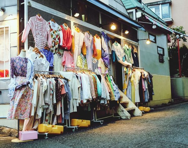 Evening shop Clothing Fashion Store Textile Industry Variation Retail  Arts Culture And Entertainment Outdoor Shop Vender Multi Colored Built Structure Hanging Architecture City
