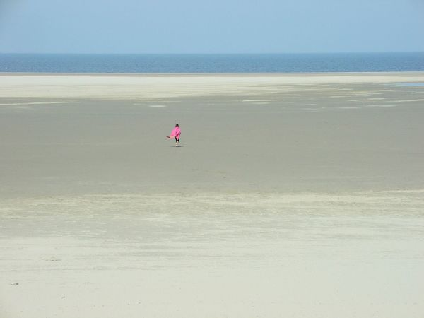 A longly woman figure covered with a pink blanket at the long ocean shelf Coast Empty Places Freedom Idyllic Longly Nature Ocean Outdoors People Of The Oceans Pink Princess Privacy Quiet Quiet Place  Sand Sea Shore Showcase June Color Of Life Colour Of Life Millennial Pink Breathing Space Lost In The Landscape