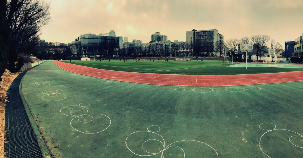 Soccer field Architecture Built Structure Building Exterior City Sport Sky Court Cloud - Sky Soccer Field Day Playing Field Panoramic Outdoors Grass Large Group Of People Tree