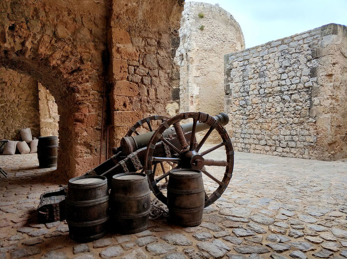 Canon on the castle of Dalt Vila. Ibiza Island. Spain Ibiza Ibiza Island Ibiza, Spain SPAIN Ancient Ancient Civilization Architecture Building Building Exterior Built Structure Cannon Dalt Vila Day History No People Old Outdoors Stone Material Stone Wall The Past Tourism Travel Destinations Wall Wall - Building Feature Wine Tun