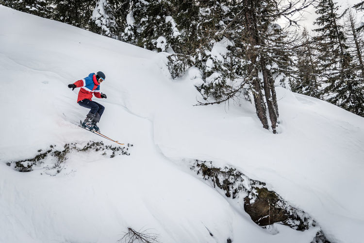Winter Snow Cold Temperature Tree Mountain Sport Winter Sport Plant Beauty In Nature Real People White Color One Person Leisure Activity Land Adventure Full Length Covering Activity Skiing Outdoors Snowcapped Mountain Extreme Weather
