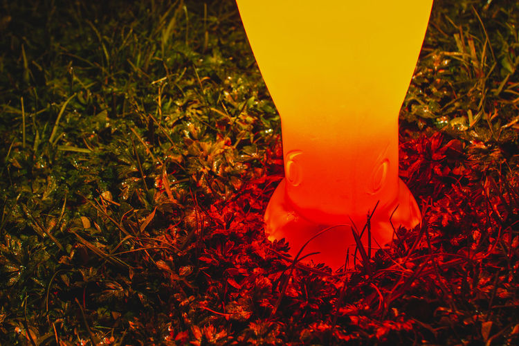 Low section of illuminated lamp on field
