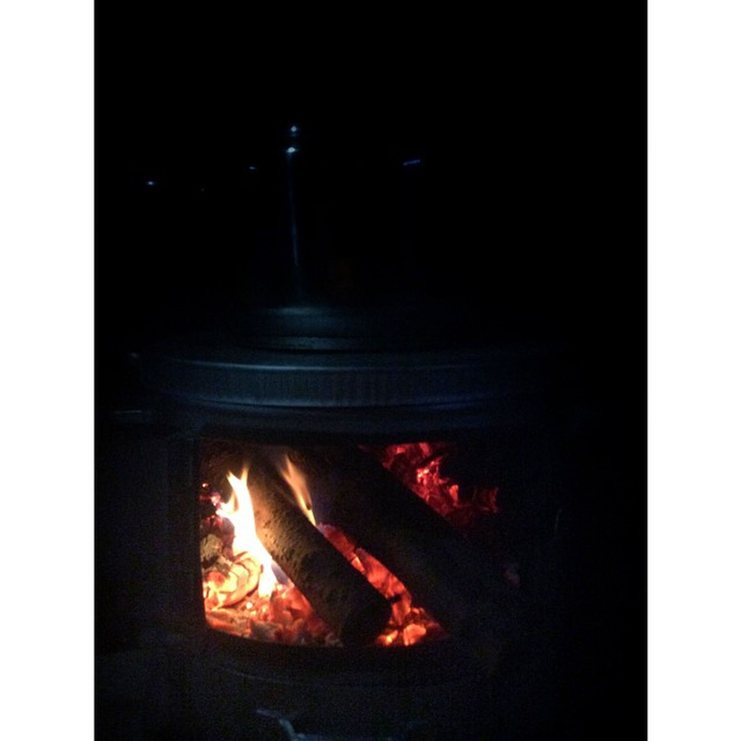 flame, burning, fire - natural phenomenon, heat - temperature, transfer print, fire, bonfire, glowing, firewood, heat, auto post production filter, night, campfire, illuminated, indoors, motion, fireplace, close-up, smoke - physical structure, dark