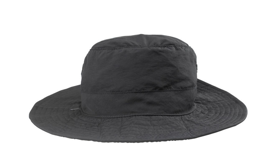 Low angle view of hat against white background