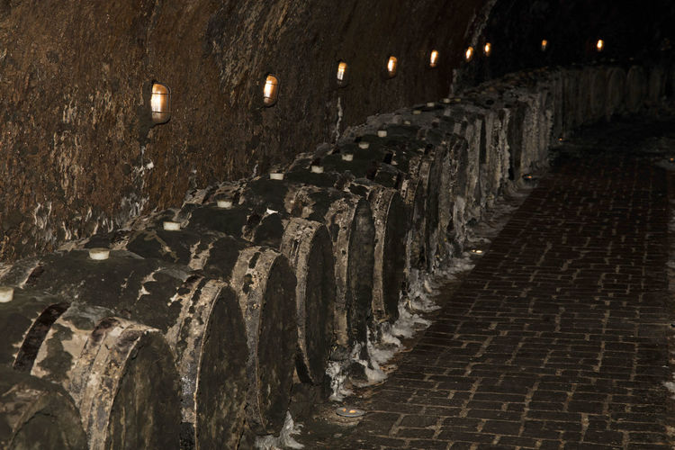 Wine ageing in old vintage wooden oak barrels covered with cellar mold in winery cellar according to traditional technology of Tokaj wine region, Hungary Aged Ageing Aging Barrel Barrels Cave Cellar Mold Mould Natural Oak Process Special Specialty Technology Time Tokaj Wine Region Traditional Wine Wine Barrels Wine Cellar Winemaking Winery Wood Wooden