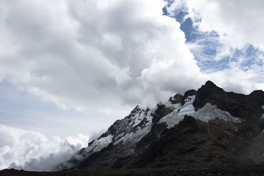 Salkantay Trek Beauty In Nature Cloud - Sky Clouds Day Extreme Weather Ice Landscape Mountain Mountain Peak Mountain Range Nature No People Outdoors Power In Nature Rock - Object Salkantay Trek Sky Snow