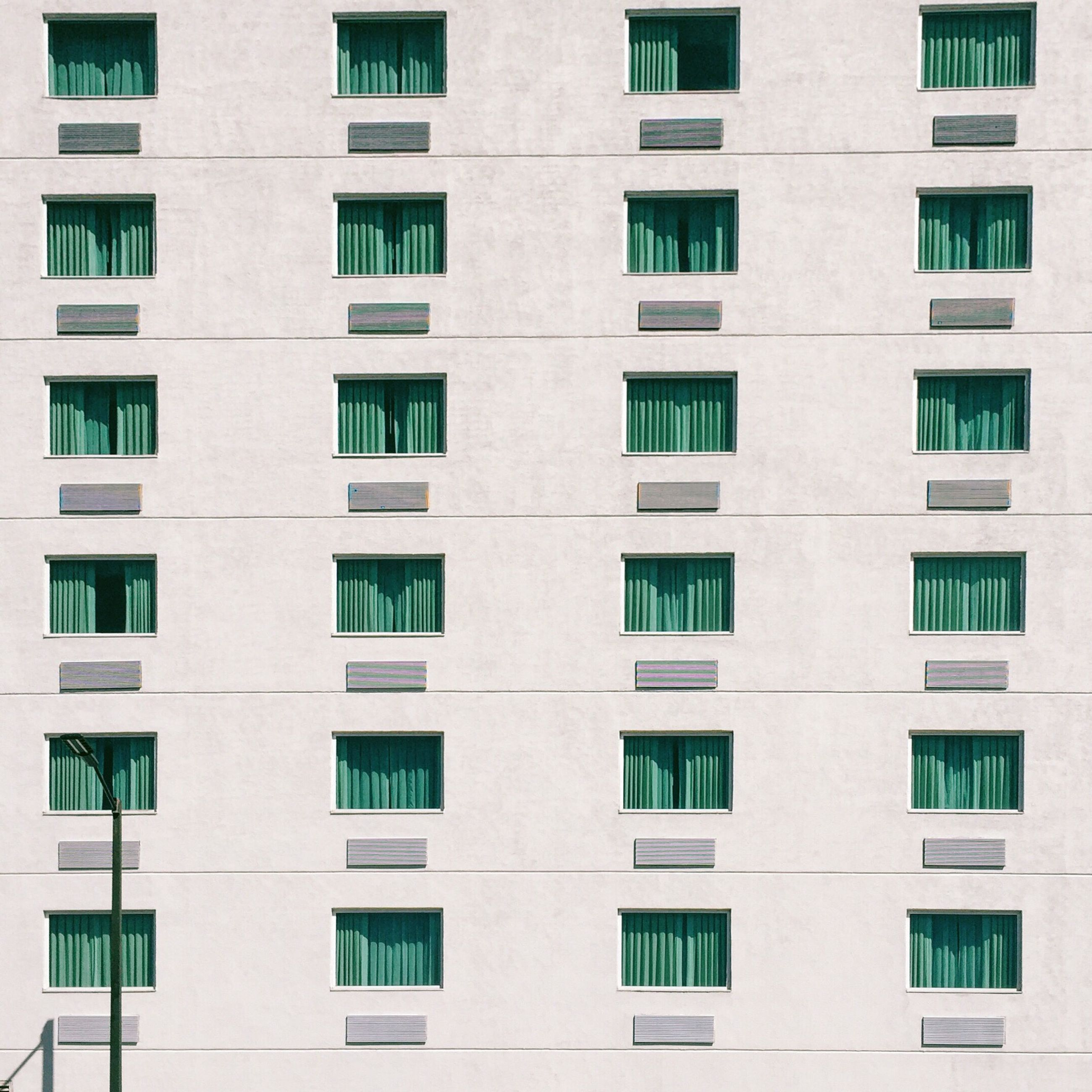 architecture, building exterior, window, built structure, full frame, backgrounds, repetition, building, residential building, in a row, apartment, low angle view, residential structure, city, day, outdoors, no people, balcony, side by side, facade