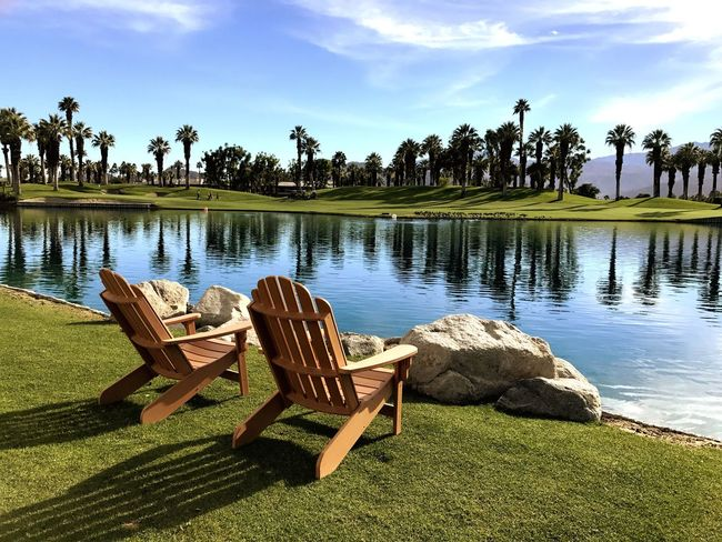Tranquility Palm Desert, CA Coachella Valley Scenic View Relaxation Empty Chairs Wooden Chairs Sunlight Palm Trees Mountains Sky
